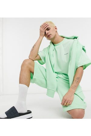 COLLUSION Shorts in green co
