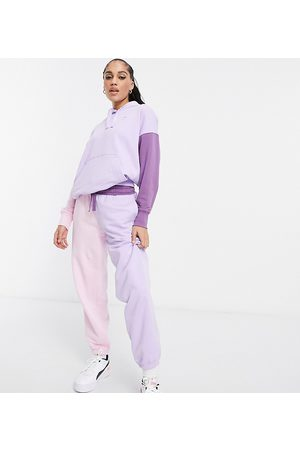 PUMA Downtown colourblock joggers in lilac and pink
