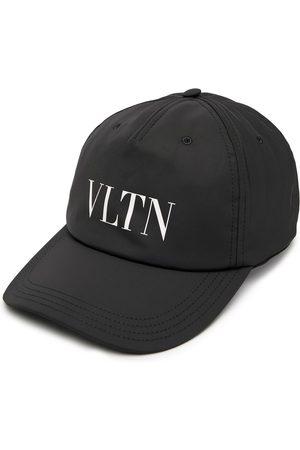 Valentino Gorra con estampado VLTN