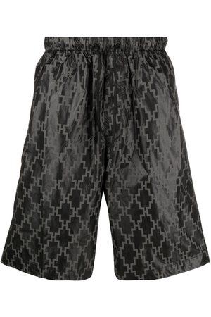 MARCELO BURLON Hombre Shorts - Logo-print track shorts