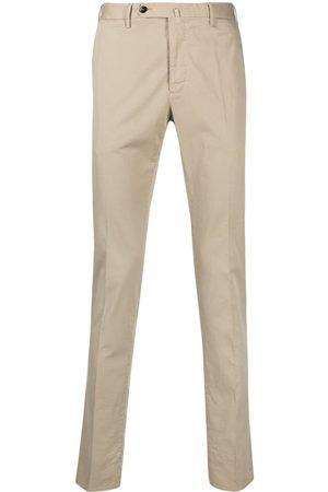 PT01 Pantalones con botón descentrado