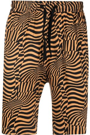 Comme des Garçons Hombre Bermudas - Psycho abstract-print shorts