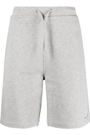 A.P.C. Pantalones cortos de deporte con logo estampado
