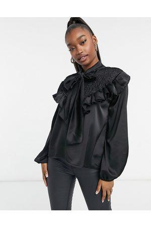 Femme Luxe Satin ruffle tie neck shirt in black