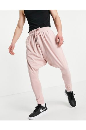 ASOS Lightweight extreme drop crotch joggers in washed pink