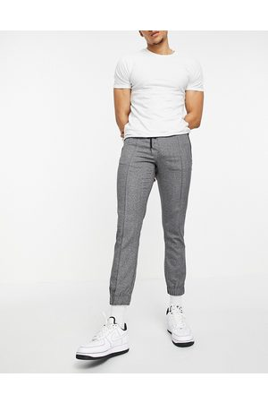 ASOS Hombre Chinos - Slim trousers with elasticated waist in textured look grey