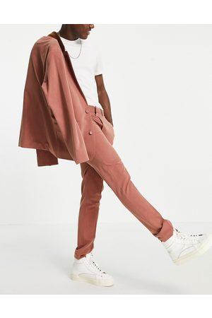 ASOS Hombre Slim y skinny - Soft tailored skinny suit trousers in rust herringbone