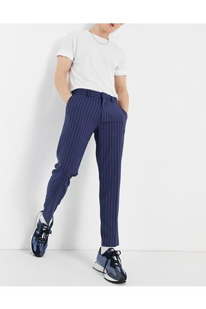 ASOS DESIGN Skinny crop smart trousers in navy and stone pinstripe