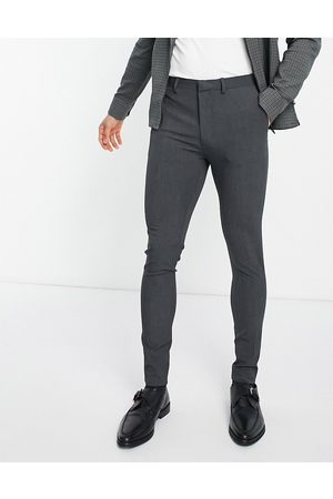 ASOS Hombre Slim y skinny - Super skinny suit trousers in charcoal