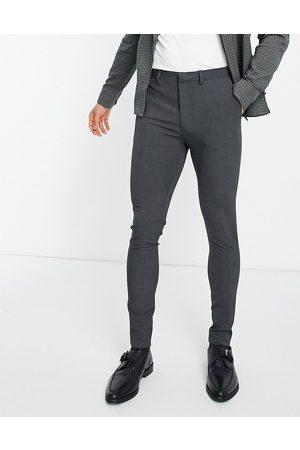 ASOS Hombre Slim y skinny - Super skinny suit trousers in charcoal