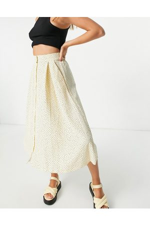 Monki Sigrid recycled button through midi skirt with in spot print