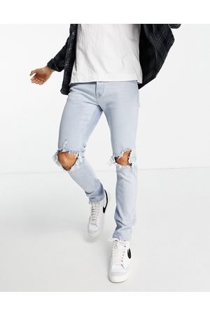 Topman Stretch skinny extreme blow out rip jeans in light wash