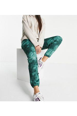 ASOS Mujer Leggings y treggings - ASOS DESIGN Tall tie dye jogger in green