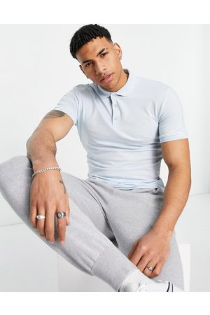 ASOS Organic muscle fit polo in blue