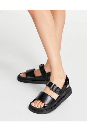 Schuh Taytum two part buckle flat sandals in black croc