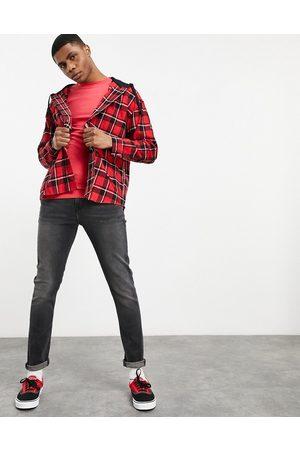 ASOS DESIGN Skinny jeans in washed black