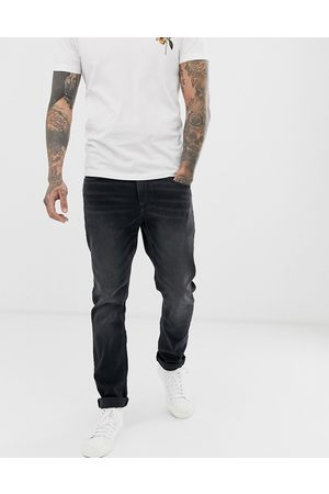 ASOS Hombre Skinny - Stretch slim jeans in washed black