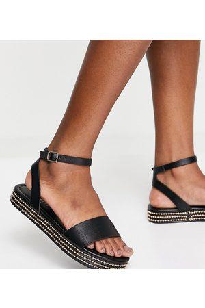 Simmi Wide Fit Simmi London Wide Fit Arvin stud flatform sandals in black