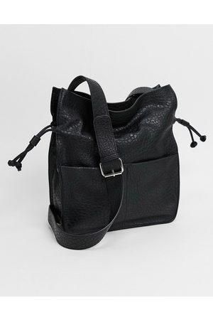 ASOS DESIGN Soft drawstring tote in grainy black PU