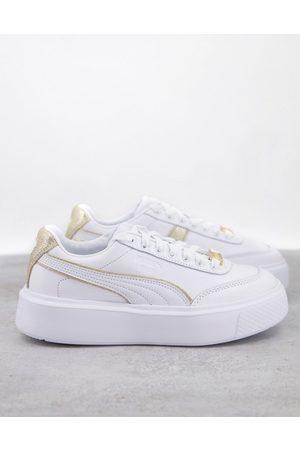 Puma Oslo Maja trainers in white and gold