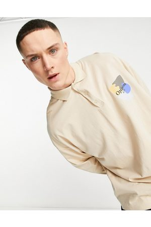 ASOS Oversized polo shirt in washed with chest print