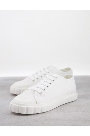 Schuh Marlo flatform cupsole trainers with black back tab in white