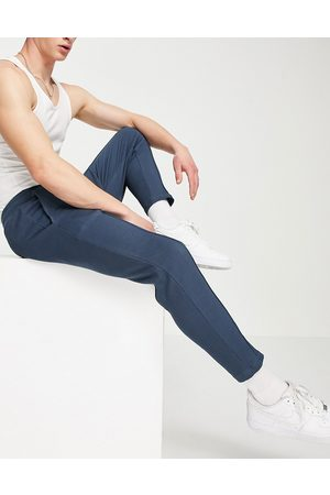 ASOS Smart waffle skinny joggers in navy with pin tucks