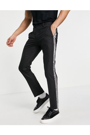 Twisted Tailor Suit trousers with silver sequin tape in black