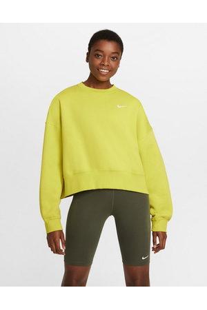 Nike Mini Swoosh oversized boxy sweatshirt in yellow