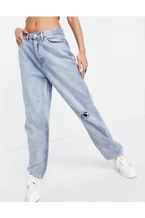 Urban Bliss Slim straight leg with rips in light wash