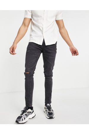 ASOS Skinny jeans in washed black with knee rips