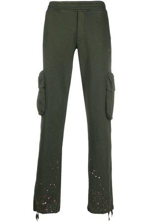 OFF-WHITE Hombre Pantalones y Leggings - Pants con motivo de salpicaduras de pintura