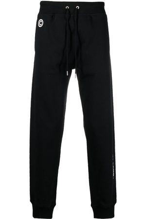 Helmut Lang Hombre Pantalones y Leggings - Impress slogan-print track pants