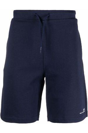 A.P.C. Hombre Shorts - Shorts deportivos con logo estampado