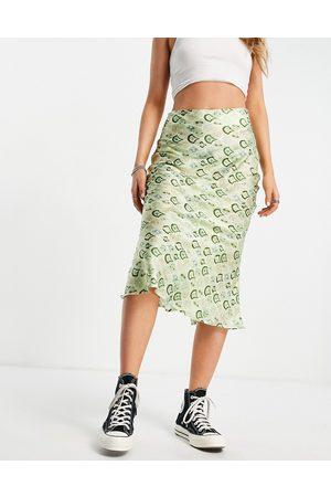 Never Fully Dressed Geometric tile print midi slip skirt co