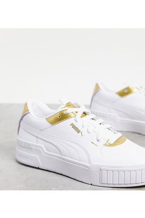 PUMA Cali Sport trainers in white and gold