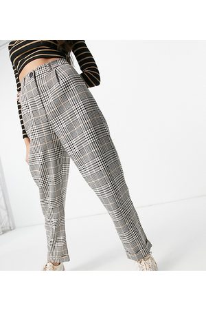 COLLUSION Peg trousers in check