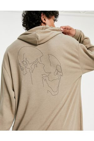 ASOS Oversized longline hoodie in viscose with skull back print