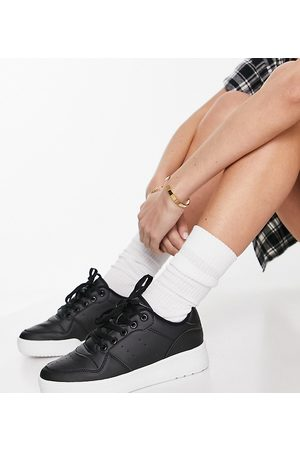 Truffle Collection Wide fit chunky flatform trainers in black