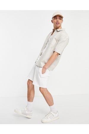 New Look Short sleeve boxy shirt in stone