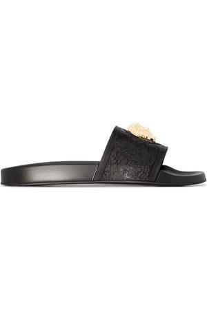 VERSACE Mujer Flip flops - Sandalias con placa de Medusa
