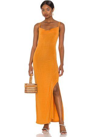 Free People Vestido bare it all en color naranja talla L en - Orange. Talla L (también en XS, S).