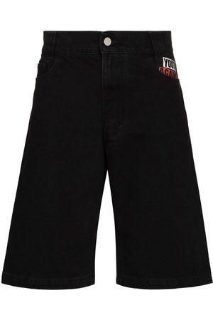 RAF SIMONS Shorts de mezclilla con parche