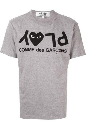 Comme des Garçons Hombre Playeras - Playera con logo estampado