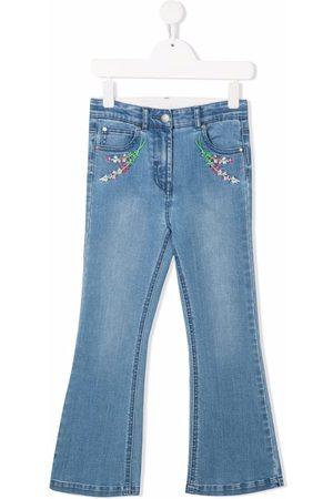 Stella McCartney Niña Jeans - Jeans acampanados con bordado floral
