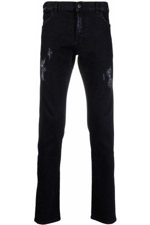 MARCELO BURLON Distressed slim-fit jeans