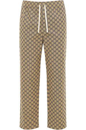 Gucci Hombre Pantalones y Leggings - Pantalones De Lona Con Piel Y G Entrelazada