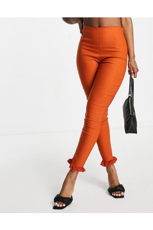 Vesper Slim trousers with ruffle detail co