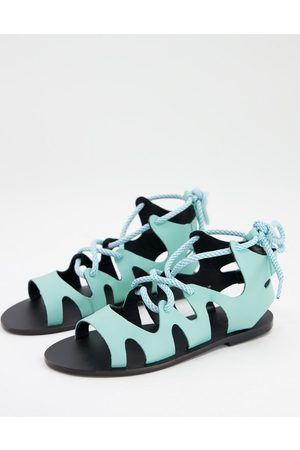 ASRA Savannah flat sandals with ankle tie in turquoise