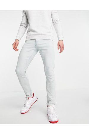Tommy Hilfiger Slim fit jeans in bleach wash denim
